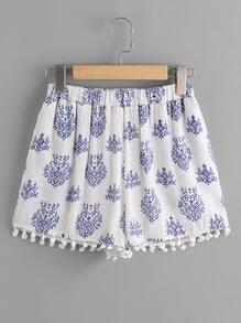 Pantaloncini con bordi con pompon