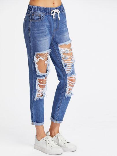 Jeans rincé lacéré avec un lacet