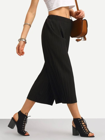 Pantalones plisado ancho