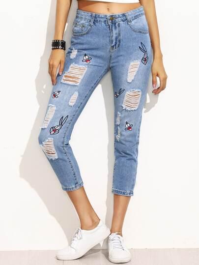 Синие рваные джинсы с вышивкой