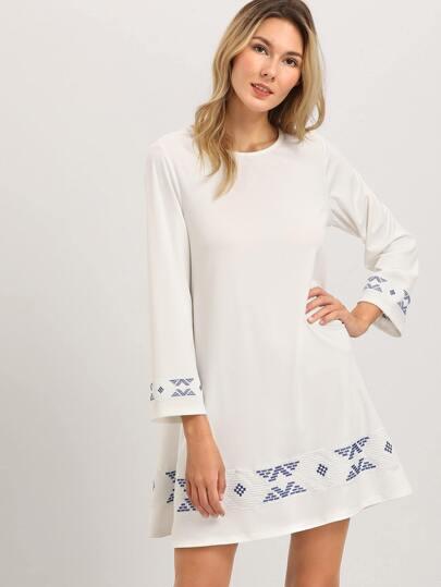 Manica Un Vestito linea lungo beige con stampa floreale