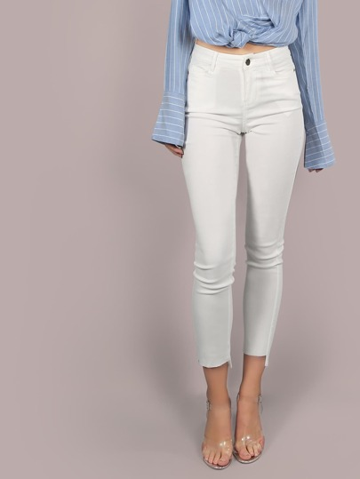 Mid Rise Dip Hem Skinnies OFF WHITE