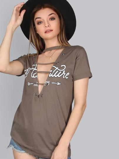 Shirt con occhielli e cinghie