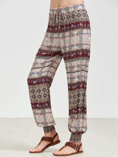 Pantalones con estampado de vintage con bajos ajustados - multicolor