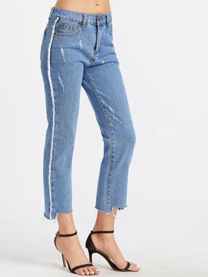 Светло-синие асимметричные джинсы