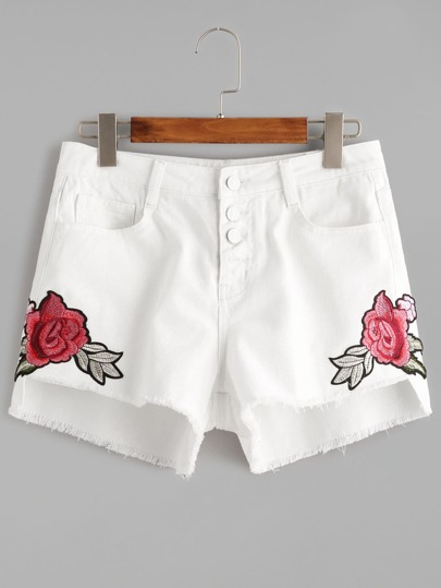 shorts in denim asimmetrici con fiore ricamato con bottoni - Bianco