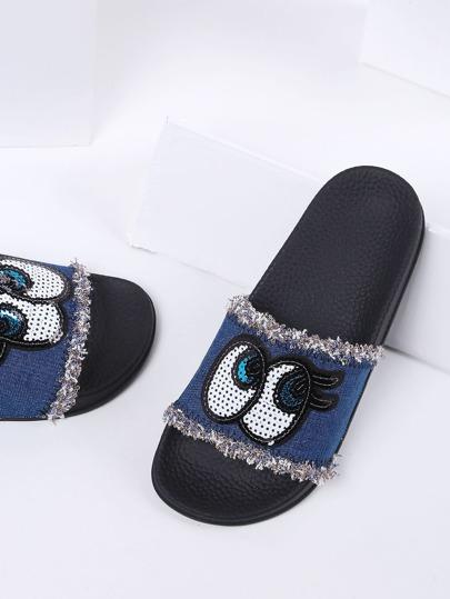 Pantoufles à fond plat bleu en denim imprimé dséfiler yeux bleu