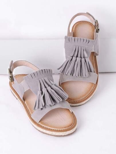 Sandales à fond plat gris avec des franges