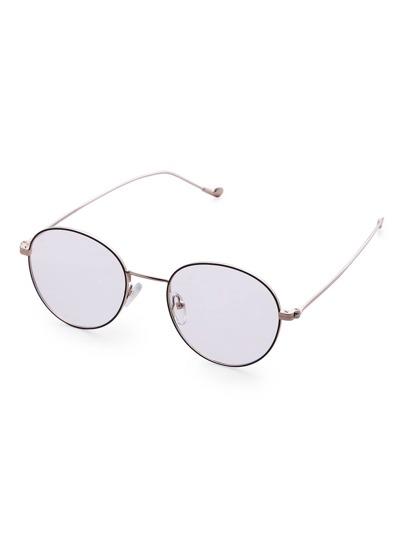 Gafas de sol con marco plateado y lentes redondas