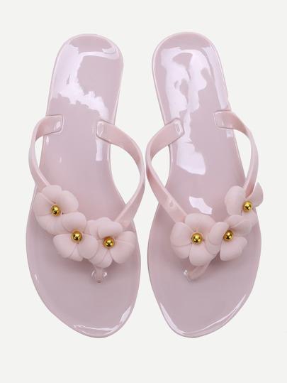 Flip-flops ornés de fleurs roses