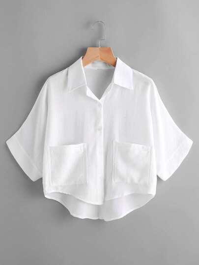 Blusa asimétrica con bolsillos en la parte delantera