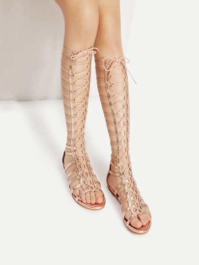 Sandalias planas enjauladas con cordones