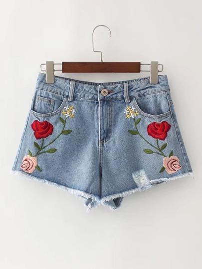 Shorts deshilachados con bordado en denim