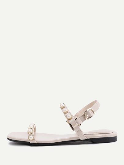 Sandales à fond plat avec des perles fausses
