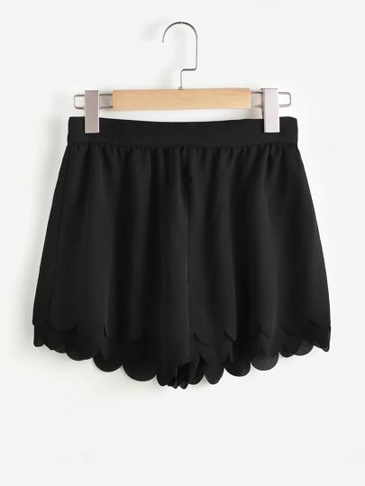 Shorts large festonné avec le zip
