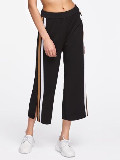 Pantalones capri de rayas lateral con abertura