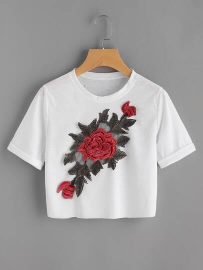 Tee-shirt avec des appliques des roses