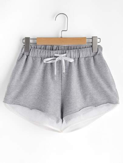 Shorts deportivos con ribete de malla con cordón