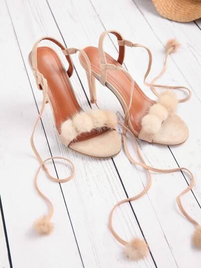 Sandalias de tacón alto con detalle de pompones con cordones