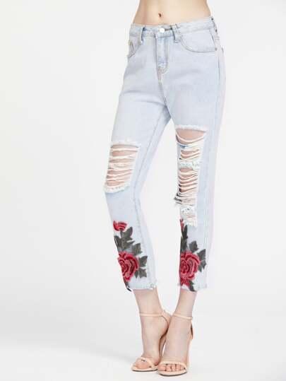 Pantalons lacéré en denim avec des appliques