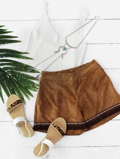 Shorts de pana con fleco bordado azteca