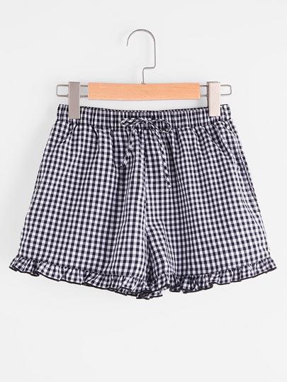 Shorts avec des plis et un lacet