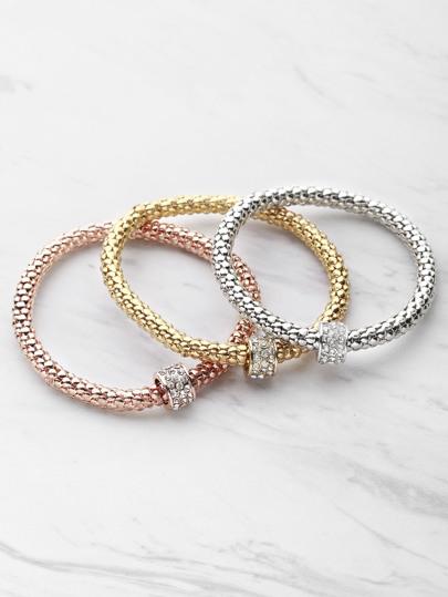 Set brazalete de metal con adornos de pedrería