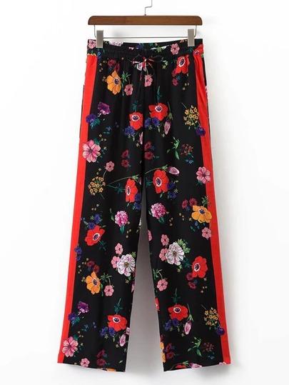 Pantaloni con fondo ampio floreale