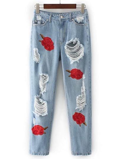 Pantaloni di jeans strappato con ricamo di rosa