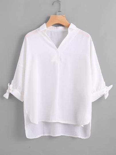 Asymmetrische Bluse mit sehr tief angesetzter Schulterpartie