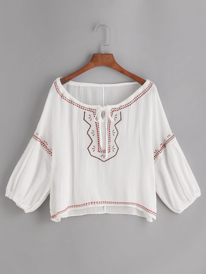 Embroidered Tie Front Dip Hem Top