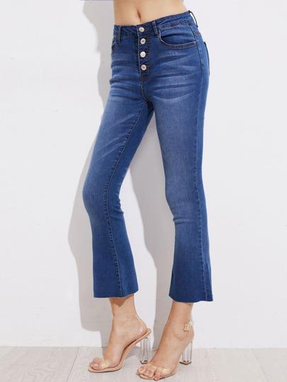 Jeans rincé avec des boutons