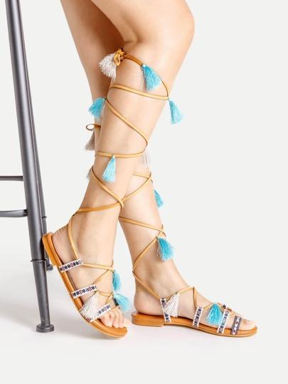 Sandales plates avec lacet et embellissement de frange