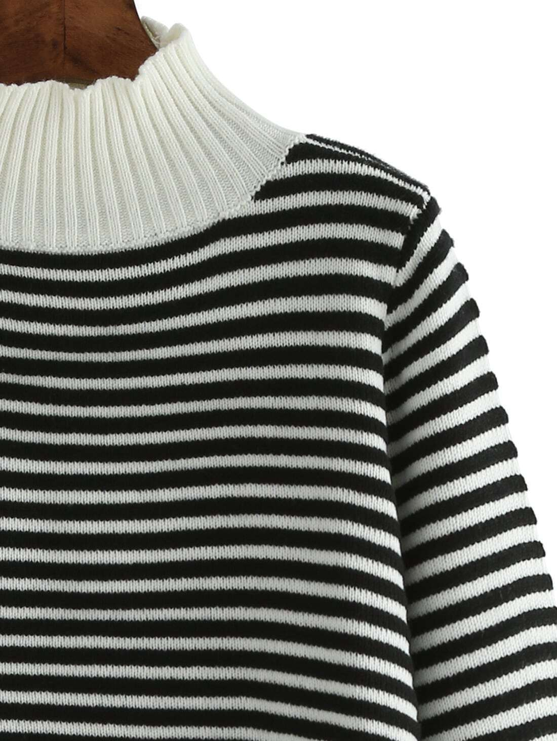 This half sleeve black and white striped dress is simple and elegant. The primary color tone used to create this sweater dress is black. However, it is hard to ignore the various white accents that appear on its outer surface.