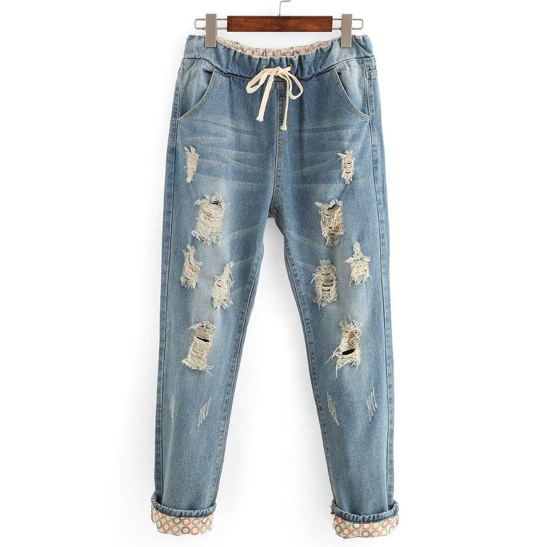 Jeans roto con cintura elástica