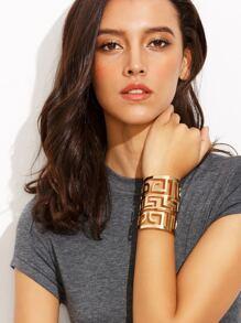 Bracelet creux motif labyrinthe - doré