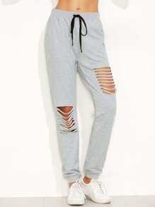 Pantalones con cordón y rocortes - gris