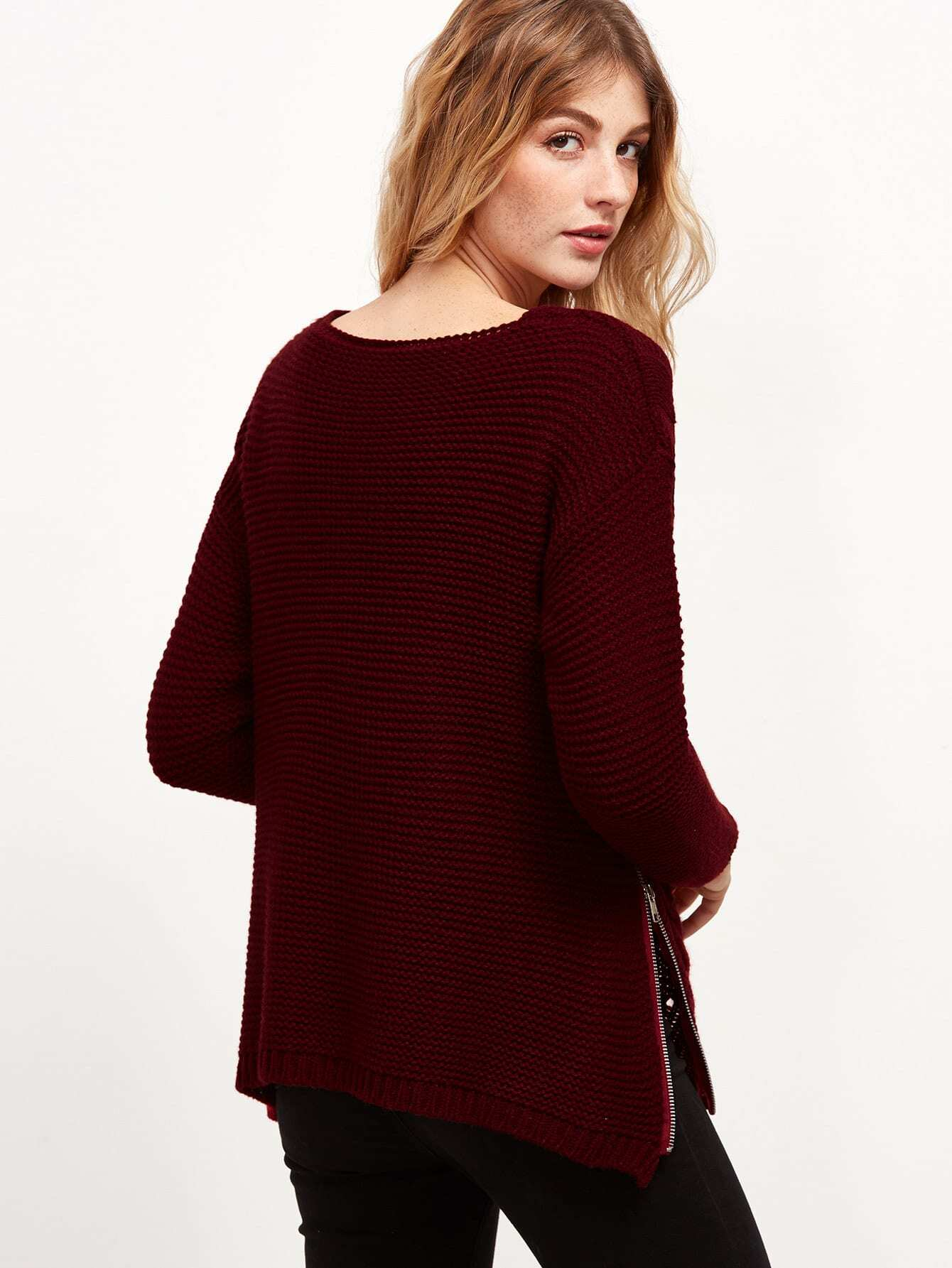 Cable-knit sweater in soft cotton-blend fabric with ribbing at neckline, cuffs, and hem.