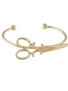 Brazalete con adorno en forma de tijeras - dorado