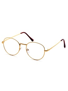 Gafas de sol con marco dorado y lentes transparente