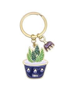 Porte-clés ton pendentif plante charnue -doré