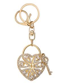Llavero con llave y corazón con abertura - dorado