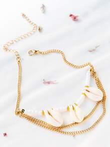 la chaîne or shell en détail les bras