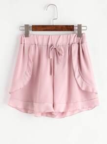 Shorts mousseline découpé rose avec des plis et lacet