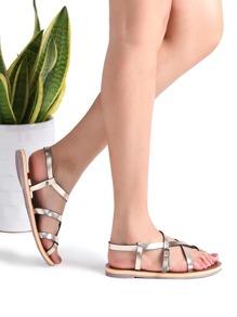Sandalias planas con detalle de cruz - dorado
