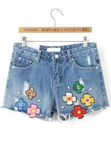 Shorts en denim bleu à motif patch brodé