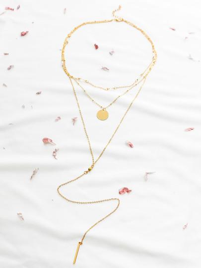 Collier pendentif en forme de barre en or à étages