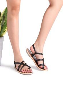 Sandalias planas con detalle de cruz - negro
