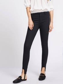 Jeans a vita bassa con aperture - nero