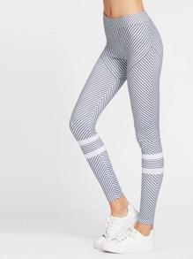 Pantalon sportif collant à rayures